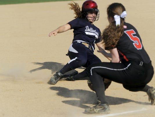 Dallastown's Gabby Jeanmenne successfully slides into third base during the Wildcats' 5-4 loss to Central York on May 4.