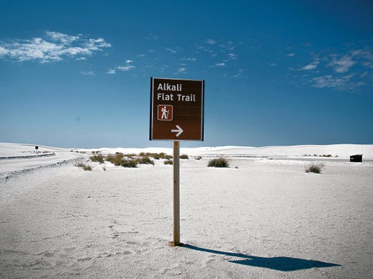 A sign points the way to the Alkali Flat Trail.
