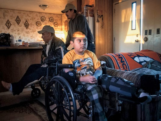 Jett Loe — Sun News file photo In January, car accident victim Raul Sanchez, then 7, watches television as his father, Leandro, a victim of the same crash, is wheeled inside by brother Noel. Leandro and his wife, Maria Sanchez, gave testimony Wednesday in a case against driver Jasmine Miller, who crashed into them in December 2014.