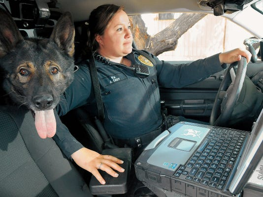 Las Cruces Police Department's newest K-9 officer Jennifer Cady sits in her vehicle with Zero, her 5-year-old German shepherd. The dog is a dual-purpose K-9 patrol and narcotics detection. The K-9 officer position is one of the most coveted at LCPD. Cady makes 45,703 annually.