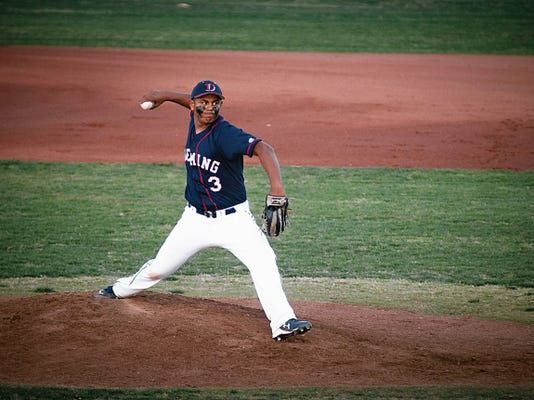 (Jett Loe/Sun-News)   Deming High School sophomore Hector Casas pitches against Las Cruces High School during Tuesday's game at the Field of Dreams in Las Cruces.
