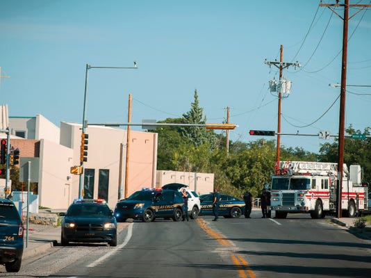 Jett Loe — Sun-News   Las Cruces police block portions of Locust Street in response to an explosion Sunday morning near Calvary Baptist Church.