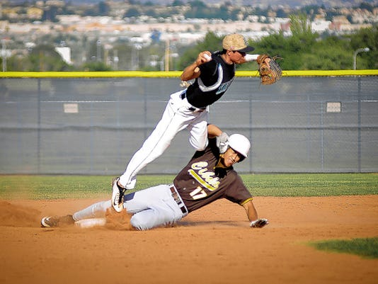 Jett Loe/Sun-News   Cibola's Jaesic Olguin slides into second to break up the double play attempt by Oñate shortstop Roman Trujillo on Friday at the Field of Dreams Baseball Complex.