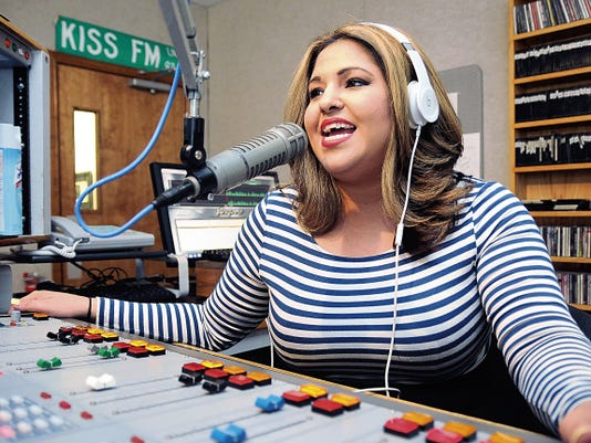 """Kiss FM radio personality Patricia Valencia works in July at the studio in El Paso. Valencia, who lives in Las Cruces and was formerly a DJ for Hot 103 and KGRT, will have a private audition with producers of the NBC show, """"The Voice"""" in Los Angeles next week."""