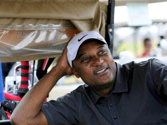 In this Nov. 11, 2011, file photo, former professional baseball player Darryl Hamilton sits in a golf cart at the Urban Youth Academy Celebrity Golf Classic, hosted by Ron Washington and Chad Gaudin, at English Turn Golf Course in New Orleans. Authorities say Hamilton was killed Sunday in a murder-suicide in the Houston suburb of Pearland, Texas. Pearland police say an initial investigation has determined Hamilton had been shot several times and that a woman in the home died of a self-inflicted gunshot wound. The woman was identified as Monica Jordan.