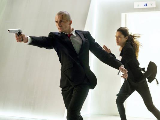 """Rupert Friend, left, and Hannah Ware appear in """"Hitman: Agent 47."""""""
