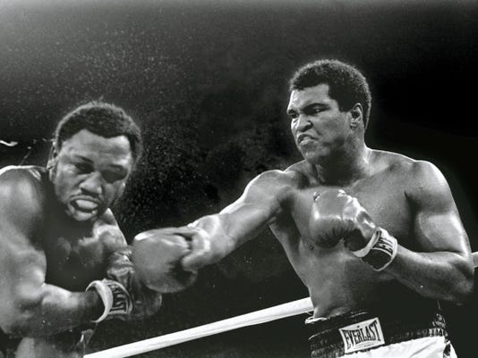 In this Oct. 1, 1975, file photo, heavyweight champion Muhammad Ali connects with a right to challenger Joe Frazier in the ninth round of their title fight in Manila, Philippines. It was, Muhammad Ali would later say, the closest thing to death he had ever known.  He and Frazier had gone 14 brutal rounds in stifling heat off a Philippines morning before Frazier's trainer Eddie Futch mercifully signaled things to an end, his fighter blind and battered and feeling pretty close to death himself. It was 40 years ago and the ''Thrilla in Manilla'' still lives in sporting lore.