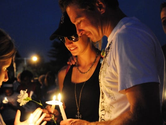 Melissa Beck of Linglestown comforts Scott Stouffer at a candle light vigil for Kortne Stouffer that was held Aug. 2, 2012, just days after her disappearance. Wednesday marks the third anniversary of that disappearance, and her family and friends still have no answers.