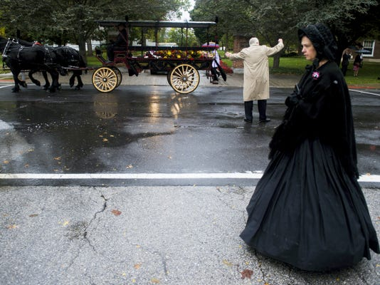 The funeral procession for James Getty makes its way down Washington Street in Gettysburg to Evergreen Cemetery on Friday.
