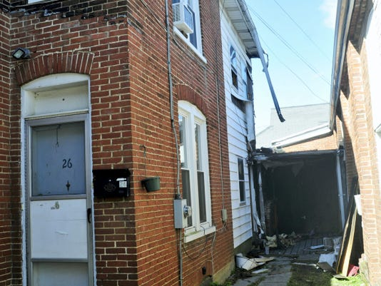Damage can be seen at an apartment building at 26 Philadelphia Avenue, Waynesboro, on Monday. A fire started Sunday around 3:30 p.m. with a discarded cigarette on the porch of a nearby apartment and spread to surrounding buildings.