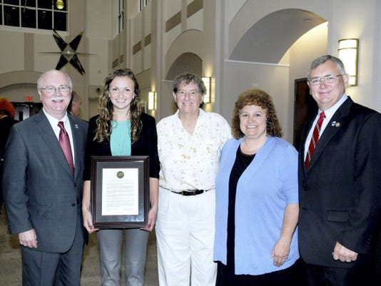Northern York graduate Lucy Kauffman was recently honored with a resolution by the Board of Governors of Pennsylvania's State System of Higher Education. Pictured are, from left, Shippensburg President Dr. Jody Harpster, Lucy Kauffman, field hockey coach Bertie Landes, mother Carol Kauffman and father Robert Kauffman.