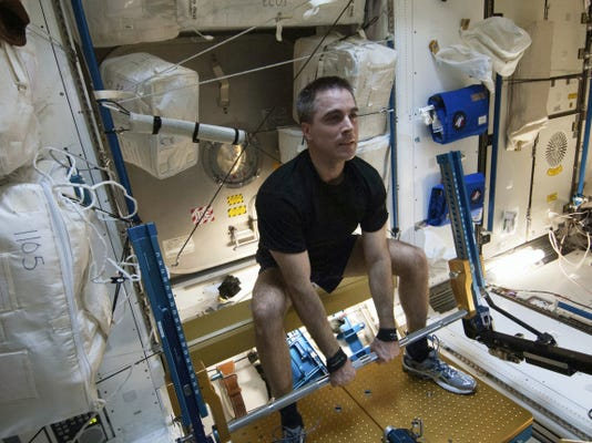 In this Aug. 31, 2013 photo made available by NASA, astronaut Chris Cassidy, Expedition 36 flight engineer, exercises on the advanced Resistive Exercise Device (aRED) in the Tranquility node of the International Space Station. In an extensive audit released Thursday, Oct. 29, 2015, NASA's inspector general office looked at the space agency's overall effort to keep astronauts healthy during lengthy space missions — especially trips to Mars, currently targeted for the 2030s. (NASA via AP)