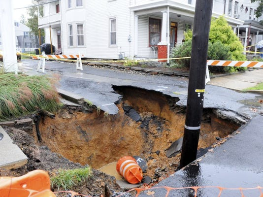 A large sinkhole stands on the south side of the 300 block of East Cherry Street in Palmyra in this file photo from October. Borough officials hope to take measures to fix the problem, but they are first awaiting word from the affected residents.
