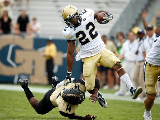Georgia Tech running back Clinton Lynch (22) is tackled