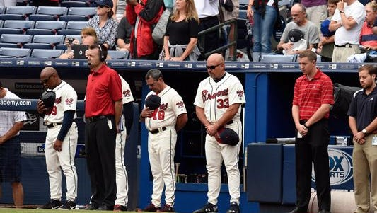 The Atlanta Braves observe a moment of silence for the fan that died after falling from the upper deck at Turner Field.