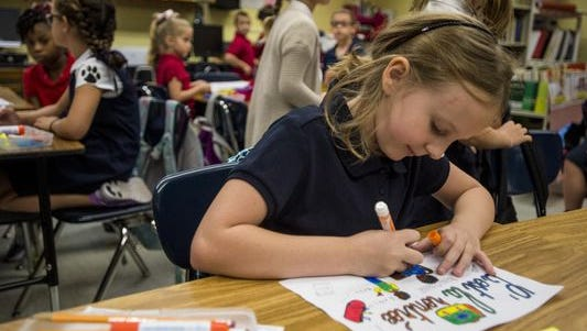 A student works on a project in a classroom at Myrtle Place Elementary last year
