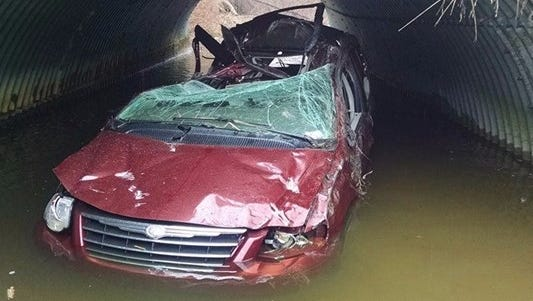 A woman lost control of her van, hit a tree and landed in the culvert in the Bellamy Creek right under West Lincoln Avenue.