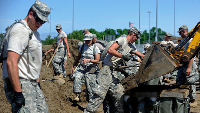 The South Dakota National Guard assemble sandbags in McCook Lake, S.D., Thursday, June 19, 2014.