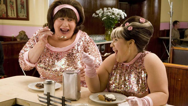 """John Travolta (left, with Nikki Blonsky) took on the role of agoraphobic Baltimore housewife Edna Turnblad in the 2007 adaptation of the """"Hairspray"""" stage musical. Harvey Fierstein originated the role on Broadway."""