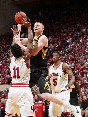 Iowa Hawkeyes forward Aaron White (30) takes a shot against Indiana Hoosiers guard Yogi Ferrell (11) at Assembly Hall. Iowa defeats Indiana 77-63.
