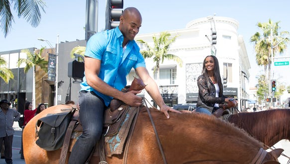Anthony and Rachel ride horses down Rodeo Drive during