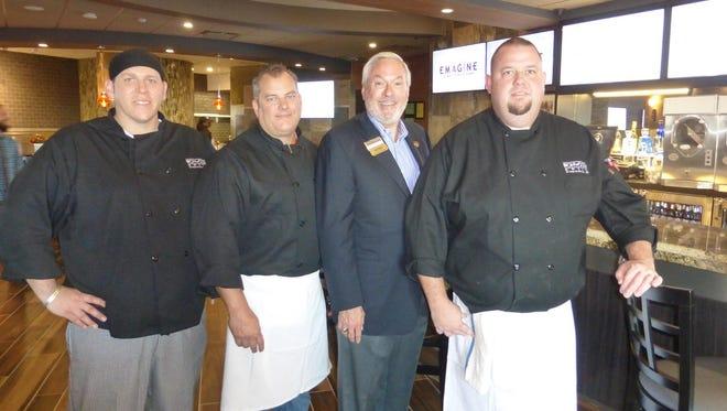 Ironwood Grill executive chef Andrew BeGole; Emagine business partners Dan Johnson, Paul Glantz, CEO and founder; and Landon Garrett II.