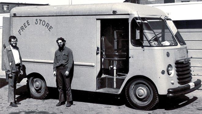 Frank Gerson with a Freestore Foodbank volunteer in front of one of the nonprofit's first trucks.