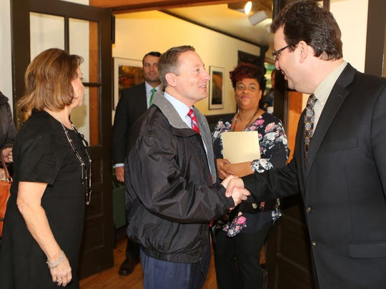 Westchester County Executive Rob Astorino greets Kevin Carter, the executive director of Teatown Lake Reservation in Ossining on Wednesday.