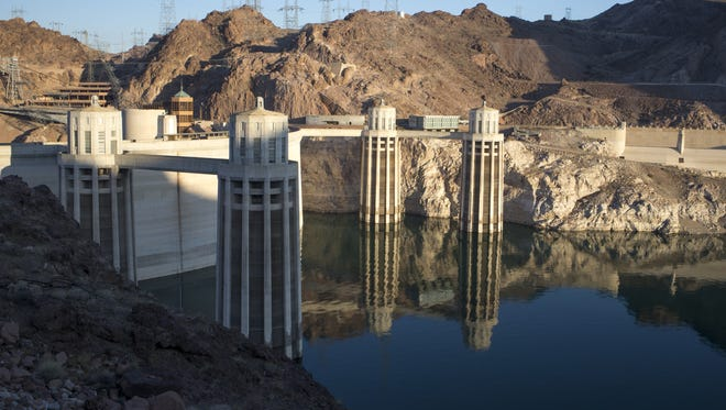 """At Hoover Dam in June 20, 2015, a light-colored """"bathtub ring"""" is visible around Lake Mead. The ring shows the lake's previous high-water mark and illustrates how much the water level has fallen."""
