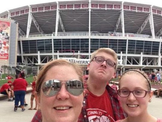 Amy Scalf and her children enjoy Cincinnati traditions such as Reds games.