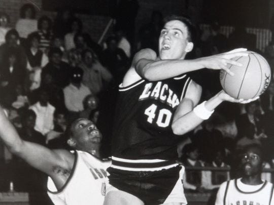 Lacey's Chris Fleming drives to the basket during a 1988 game.