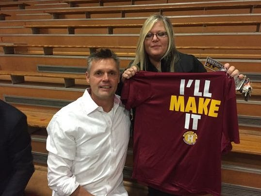 "The man who played Jimmy Chitwood, Maris Valainis, takes a photo with a T-shirt with Chitwood's famous line from ""Hoosiers."""