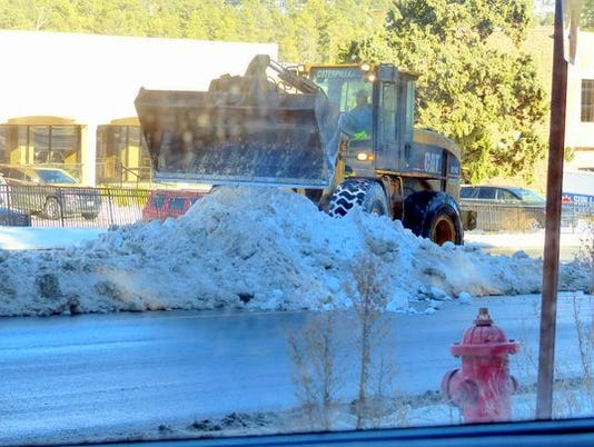 shoveling-street-snow