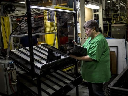 Sue Koehler inspects an automotive component Thursday, Feb. 9, 2017 at US Farathane Corporation in Port Huron.