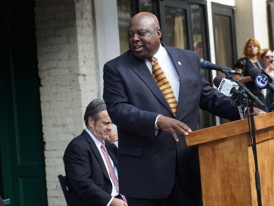 Gary Fullman, chief of staff to then-Mayor Dennis P. Williams, speaks at a press conference announcing a new loan program for small businesses along Market Street in August 2016.