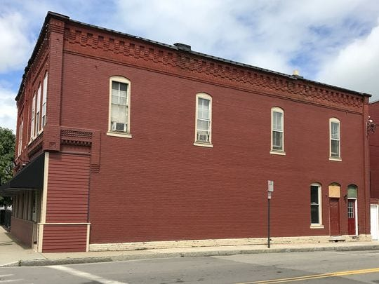 This is what the outside of Brick House Brewery looked like before artist Brett Steeves painted a mural on the building.