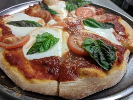 La pizza margherita en The Quartiere.