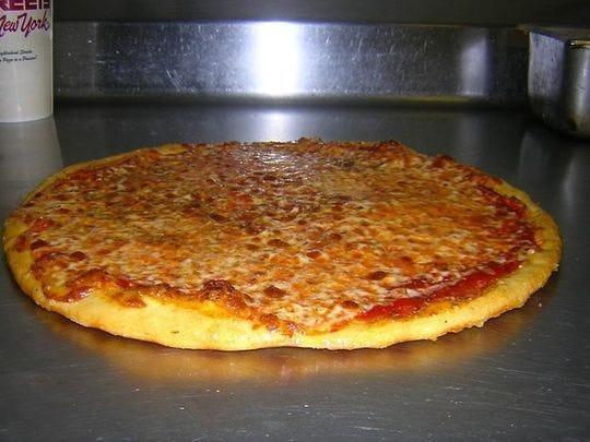 Compre una porción de pizza y obtenga una gratis en