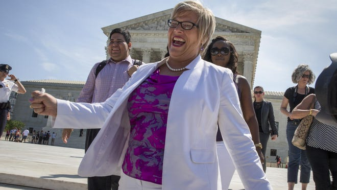 Amy Hagstrom Miller, founder of Whole Woman's Health, a Texas women's health clinic that provides abortions, rejoices as she leaves the Supreme Court in Washington, Monday, June 27, 2016, as the justices struck down the strict Texas anti-abortion restriction law known as HB2.