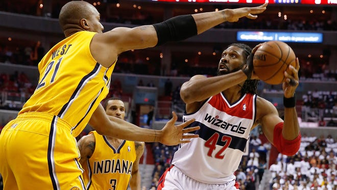 Washington Wizards forward Nene looks for a way around Indiana Pacers forward David West during Game 6 of the Eastern Conference semifinals. Indiana won 93-80, and won the series 4 games to 2.
