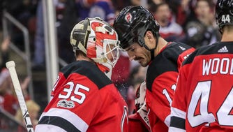 New Jersey Devils center Brian Boyle (11) celebrates with goalie Cory Schneider (35) after their game against the Dallas Stars during the third period at Prudential Center in Newark on Friday, Dec. 15, 2017.