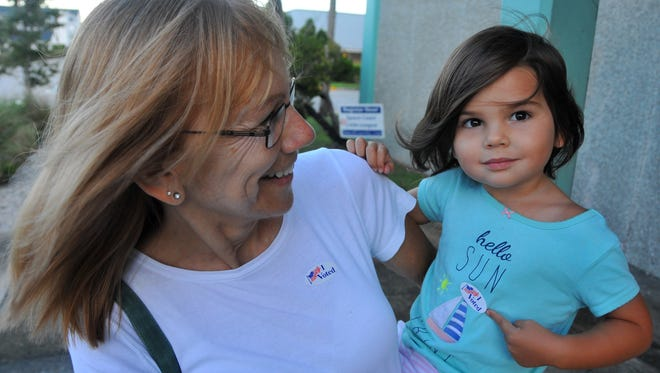 """After voting at Ramp Road Rec. Center in Cocoa Beach early Tuesday, Donna Jones and her granddaughter Ave Walker proudly show their """"I Voted"""" stickers. The polls opened at 7:00 a.m., with people waiting in line at most voting sites. #321vote"""