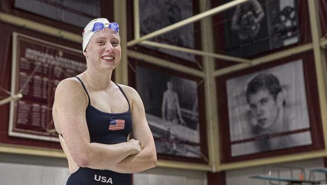 Lilly King poses in front of a wall depicting fellow Indiana University Olympic swimming medalists at Counsilman-Billingsley Aquatic Center, Bloomington, Ind., Monday, August 29, 2016. King won gold in the 100 meter breaststroke and the 4 x 100 meter medley at the 2016 Rio Summer Olympics.