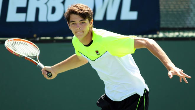 Top seeded player Taylor Fritz plays Connor Hance on Wednesday, April 8, 2015 during the Easter Bowl at the Indian Wells Tennis Garden.