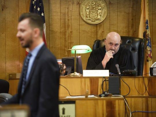 Judge Adam E. Jacobs listens as  Prosecutor Krenar
