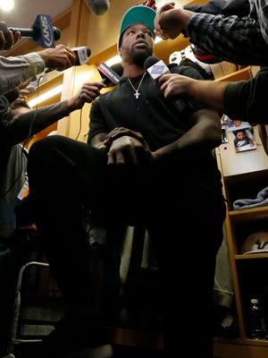 Giants DE Jason Pierre-Paul was surrounded by reporters Friday.