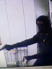Image of a suspect robbing a Thrifty liquor.