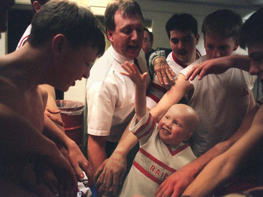 Then 5-year old Zachary Tatro was at the center of a Palmyra-Macedon basketball team's cheer celebrating a victory in the Class B semifinal versus Wayne in a War Memorial locker room. Chip Tatro, Zachary's dad, is second from left.