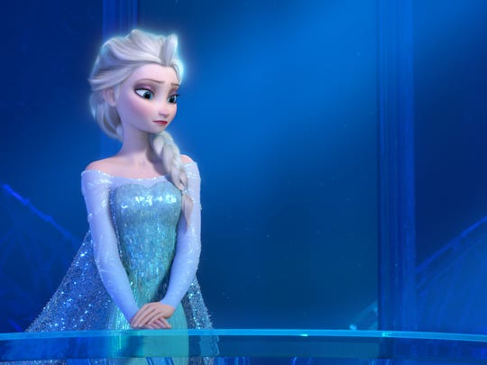 "This image released by Disney shows a teenage Elsa the Snow Queen, voiced by Maia Mitchell, in a scene from the animated feature ""Frozen."" The movie's popularity has spilled over into demand for ""Frozen""-related merchandise, trips and visits with ""Frozen"" characters at Disney parks. (AP Photo/Disney) ORG XMIT: NYET314"