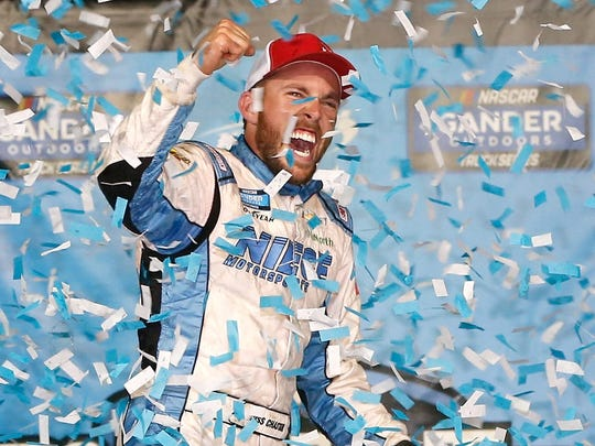 KANSAS CITY, KS - MAY 10:  Ross Chastain, driver of the #45 TruNorth/Paul Jr. Designs Chevrolet, celebrates in victory lane after winning the NASCAR Gander Outdoors Truck Series Digital Ally 250 at Kansas Speedway on May 10, 2019 in Kansas City, Kansas.  (Photo by Brian Lawdermilk/Getty Images) ORG XMIT: 775339628 ORIG FILE ID: 1142704797